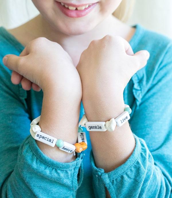 Little girl with DIY Thanksgiving bracelets.