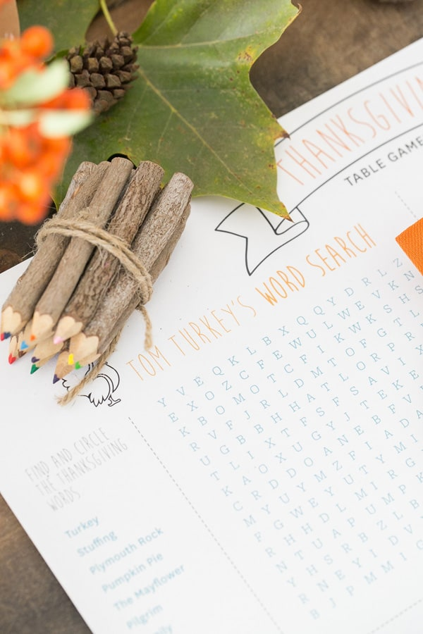 Thanksgiving word search for kids and wooden crayons.