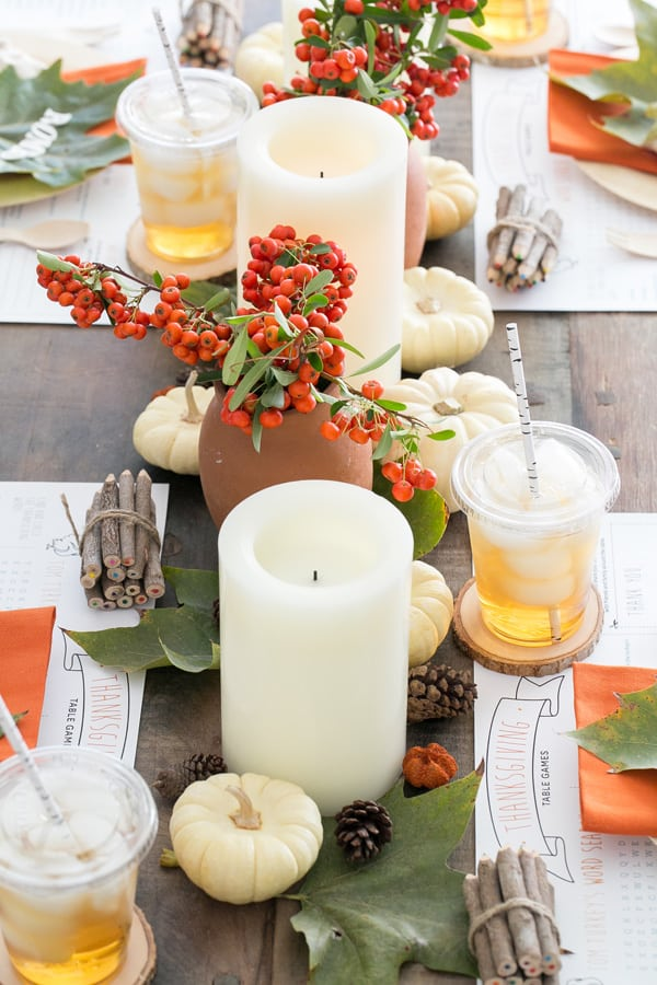 Kids Thanksgiving Table with flameless candles and flowers.