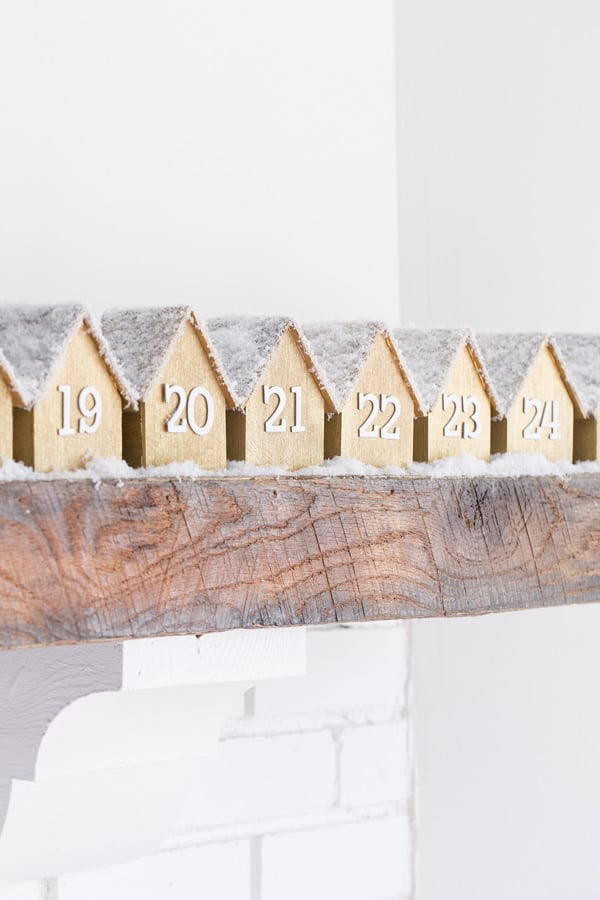 This Year S Diy Advent Calendar Is Definitely My Favorite So Far These Tiny Wooden Houses Lined Up On Mantle Are Just About The Most Charming Christmas