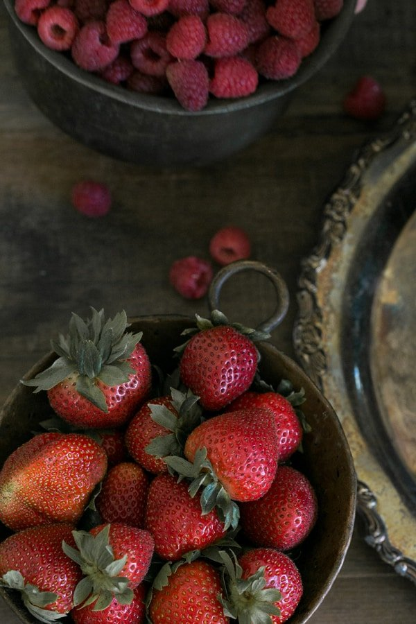 close up of strawberries in a bowl