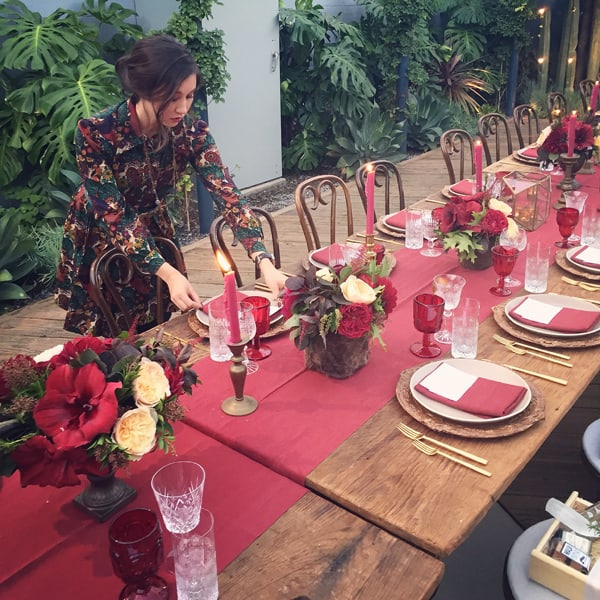 Angel Swanson setting a red wedding table