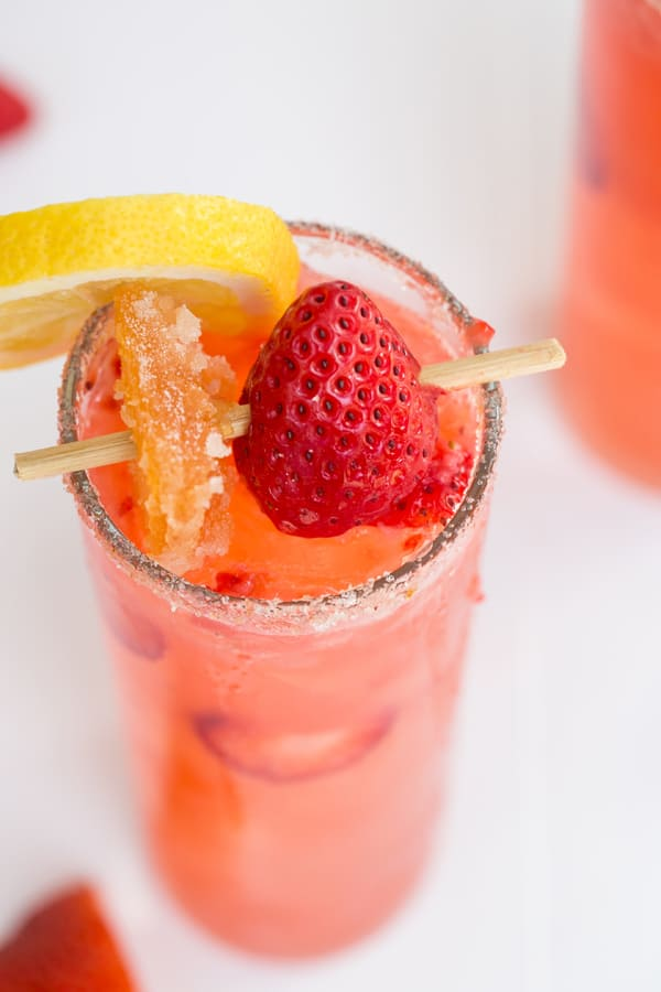 Grapefruit Strawberry Collins in a tall glass.