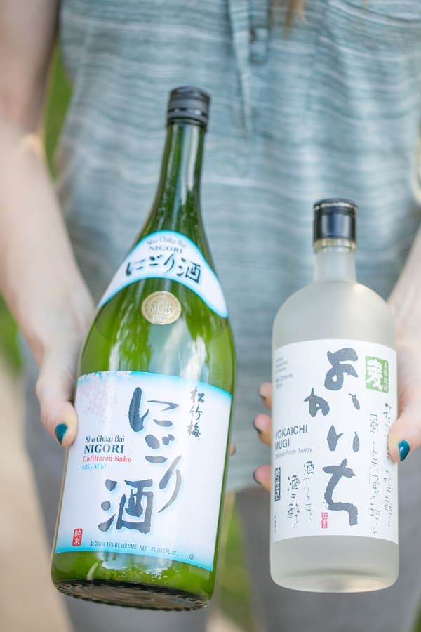 shot of a sake and a soju bottle
