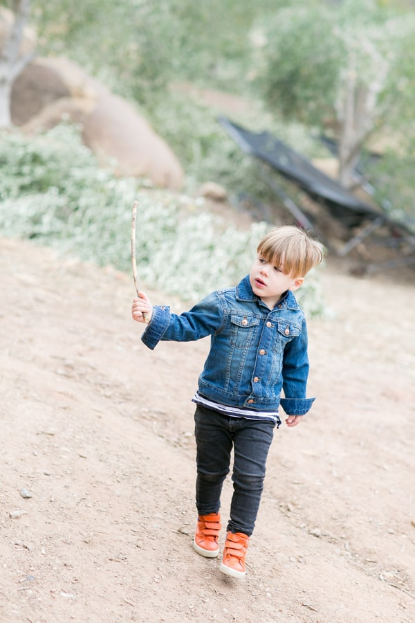 Little boy with orange boots waling in Ojai
