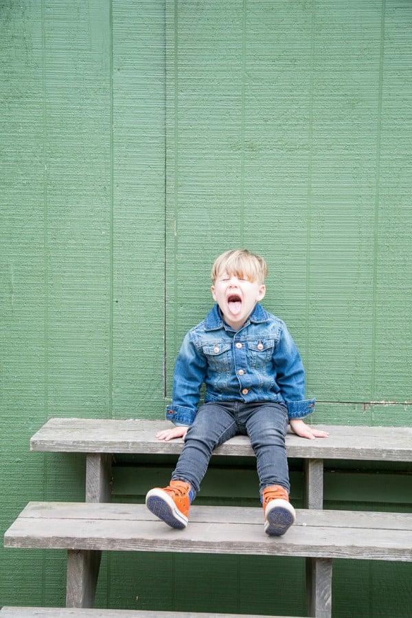 Little boy sitting on step in Ojai