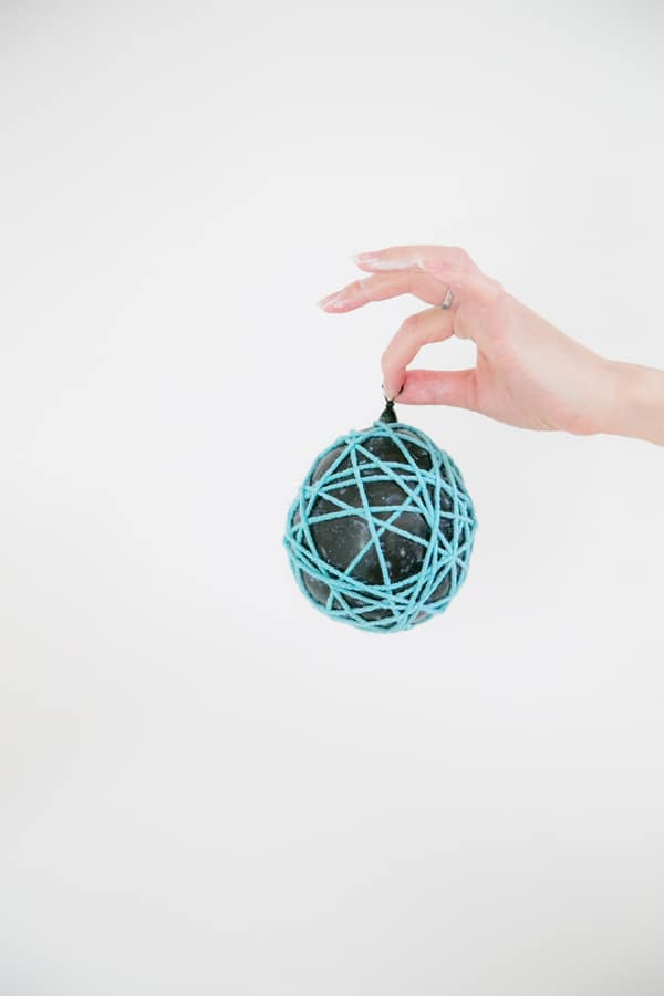 Balloon wrapped in yarn with glue.