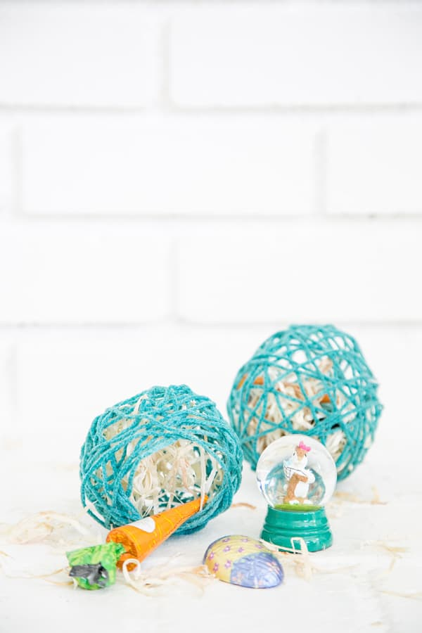 Eggs made with yarn and treats inside.