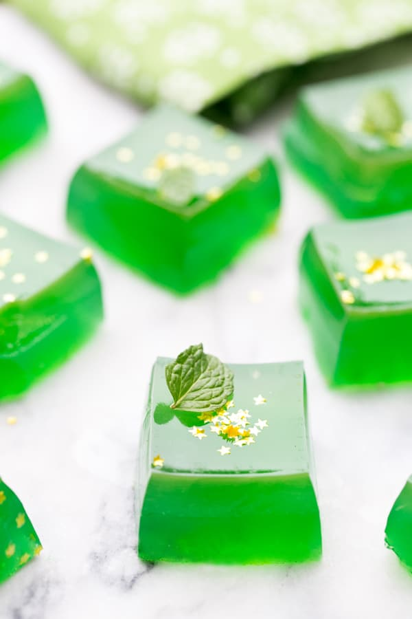 Green Irish Whiskey Jello Shots with mint and edible gold stars.