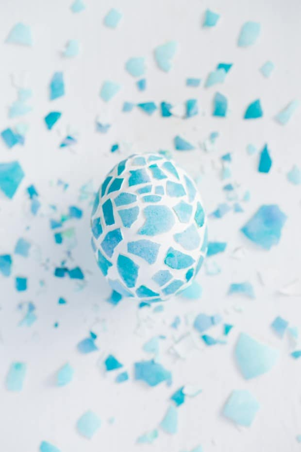 A white and blue Mosaic easter egg with cracked blue shells.