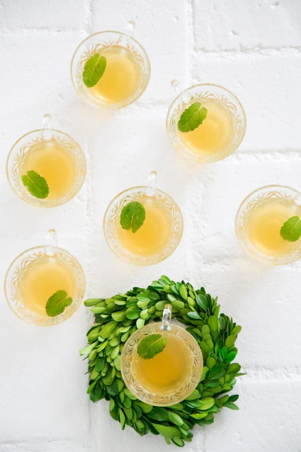top down shot of tea cocktail in glasses with mint leaf.