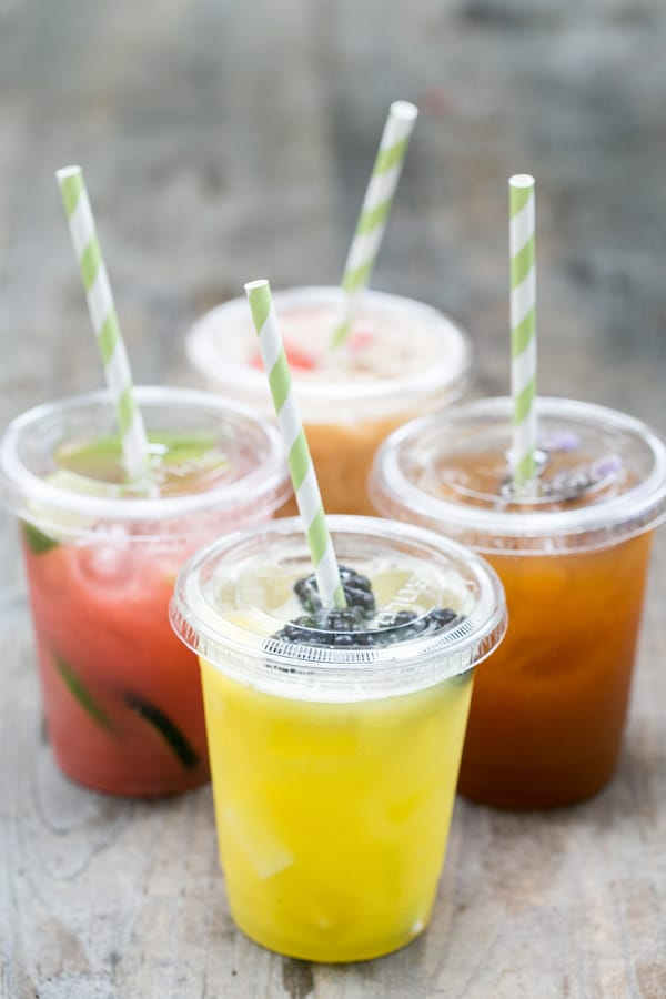 Agua Fresca in clear glass cups with green straws.