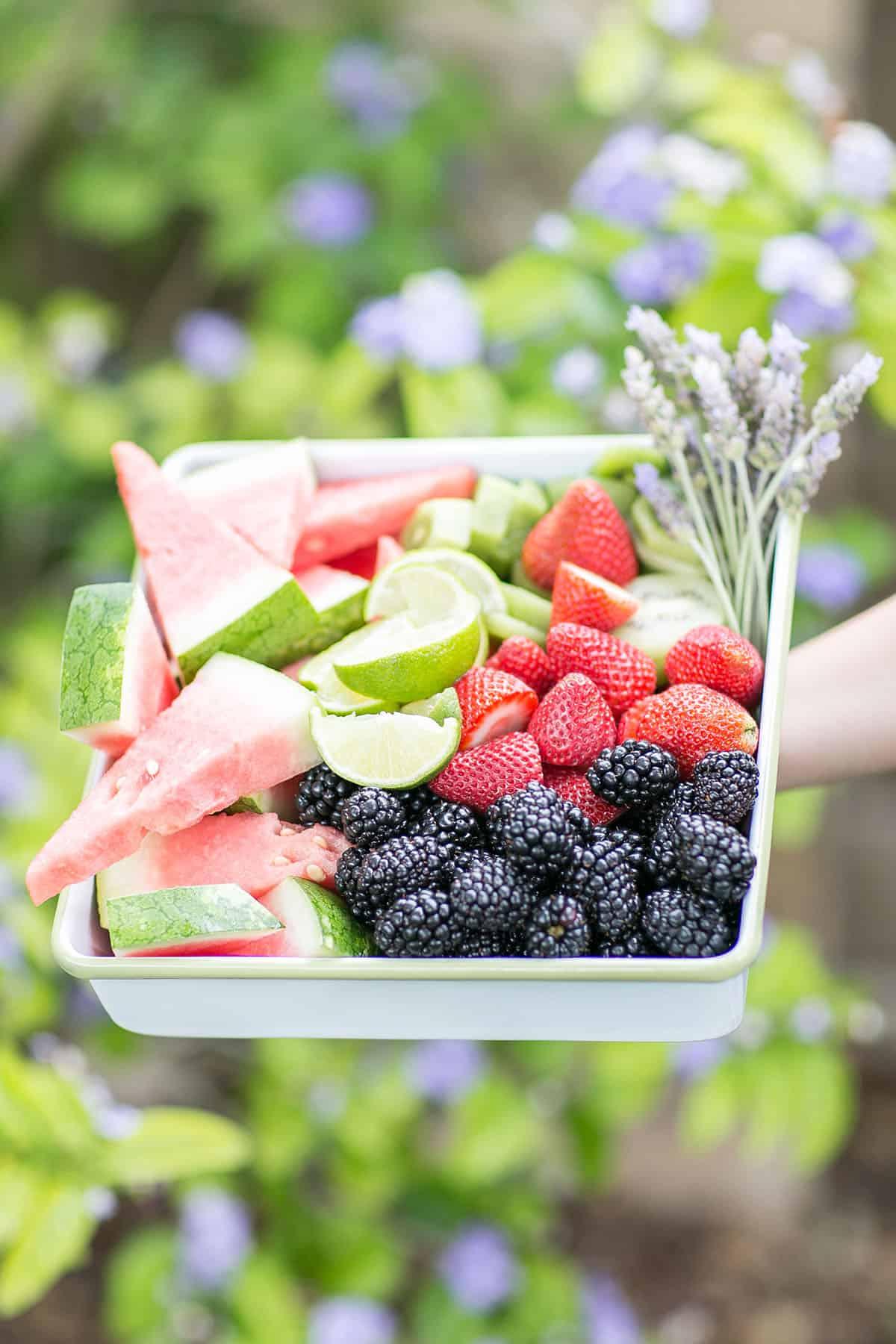 fruit sliced for an agua fresca bar