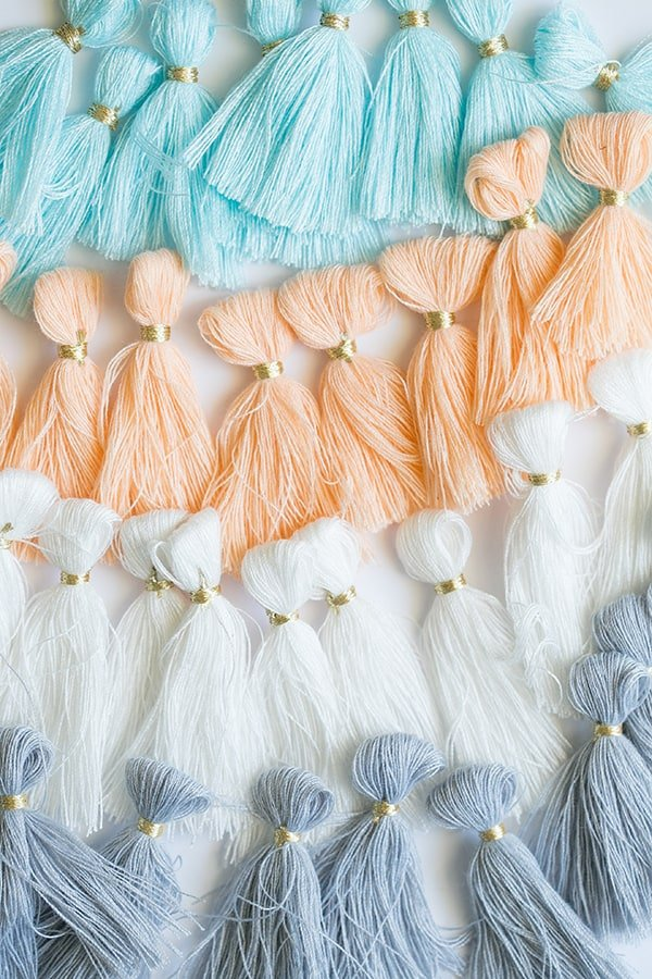Blue, white, orange and white tassels