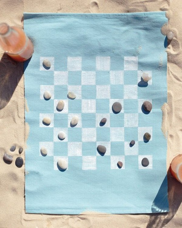 DIY checkers game on the beach