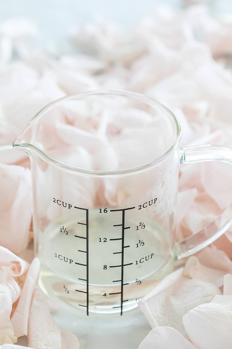 Measuring cup with rose water.