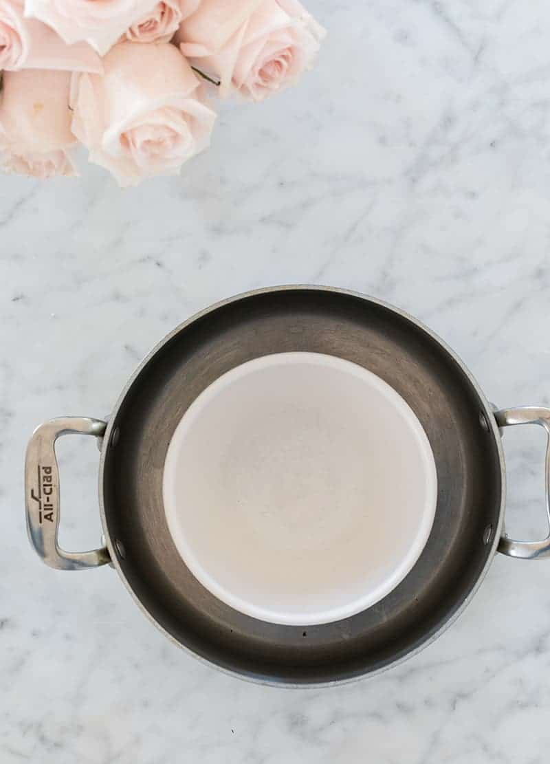 Small bowl in the middle of a larger pot
