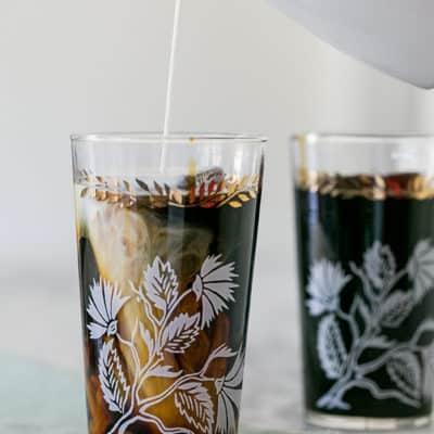 Adding cream to cold brew coffee