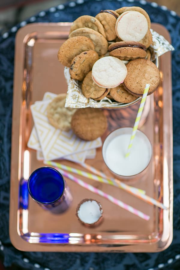Gold tray with cookies and milk