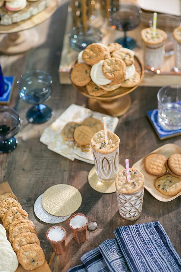 Table filled with cookies and cocktails