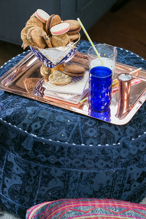 Cookies on a blue pouf with copper tray