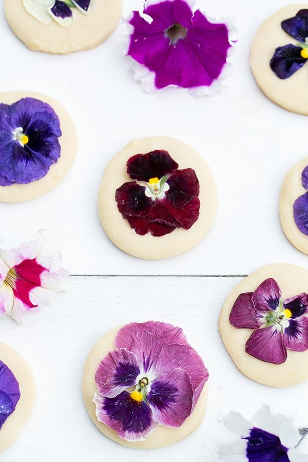 Shortbread cookies decorated with flowers on a wooden work surface