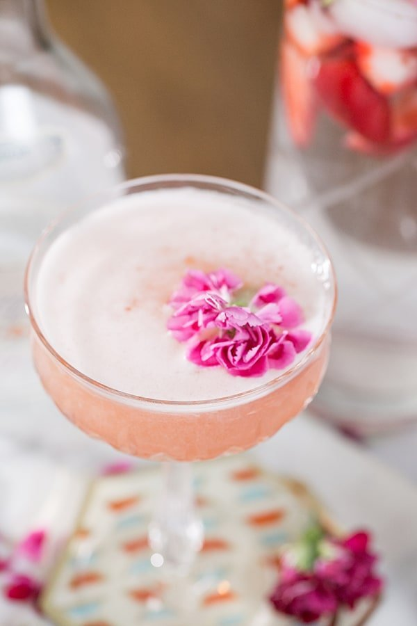 close up shot of gin cocktail with flower