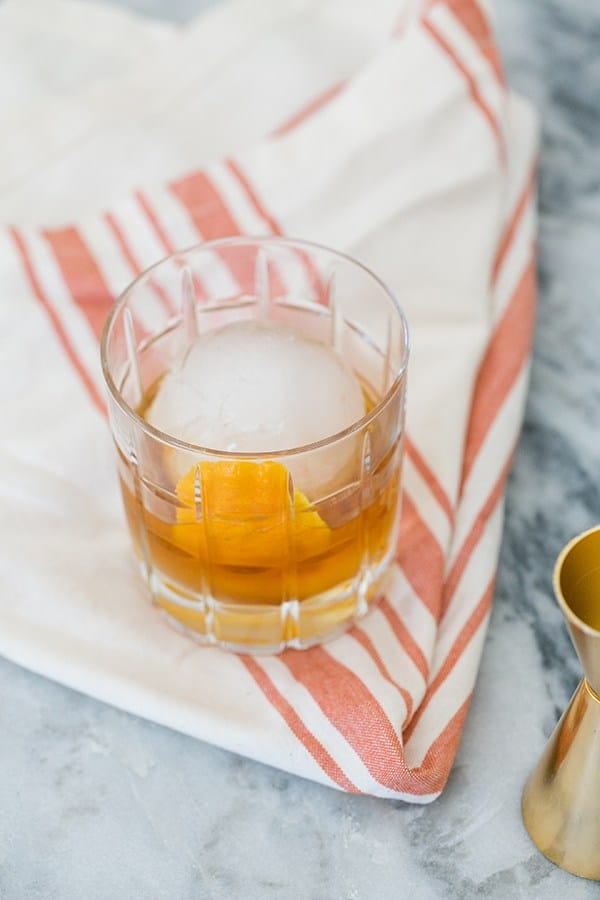 old fashioned cocktail with large round ice cube