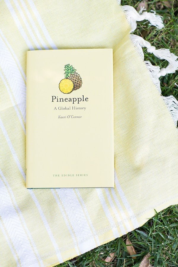 Pineapple history book on a yellow towel.