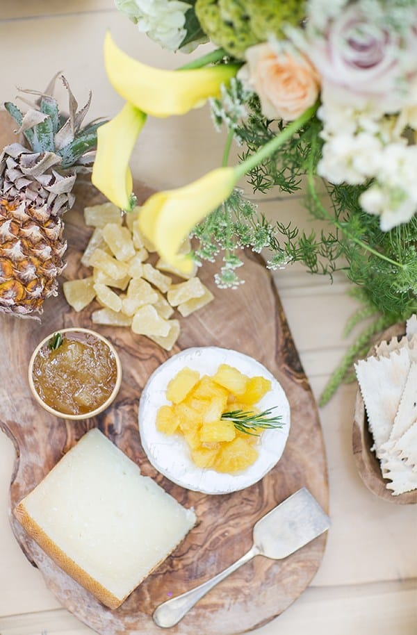 Pineapple cheese plate with dried pineapple and baby pineapple.