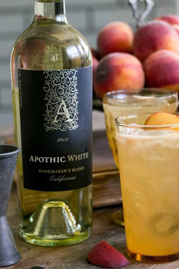 Bottle of Apothic White wine with two tall cocktails in a glass.