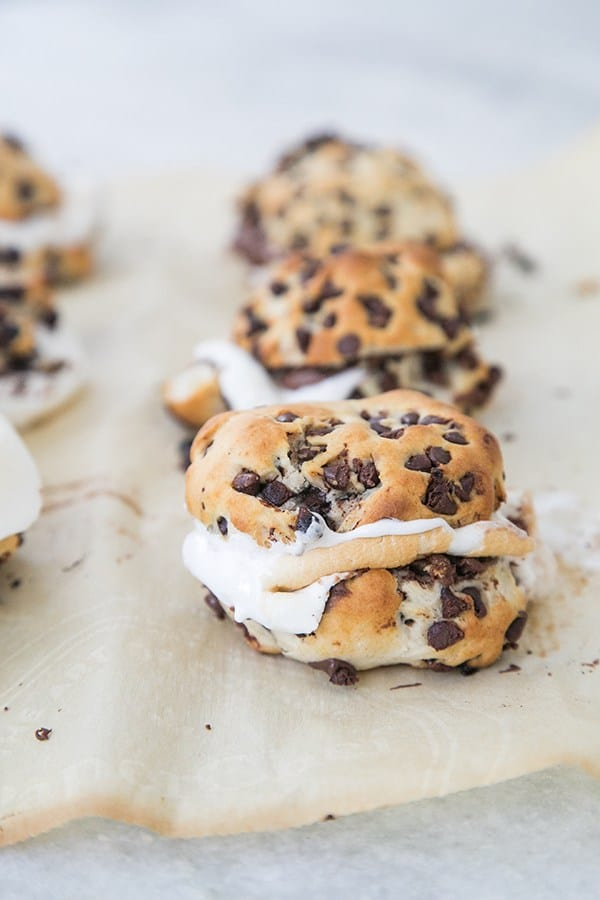Two biscuits with chocolate chips and marshmallow inside.