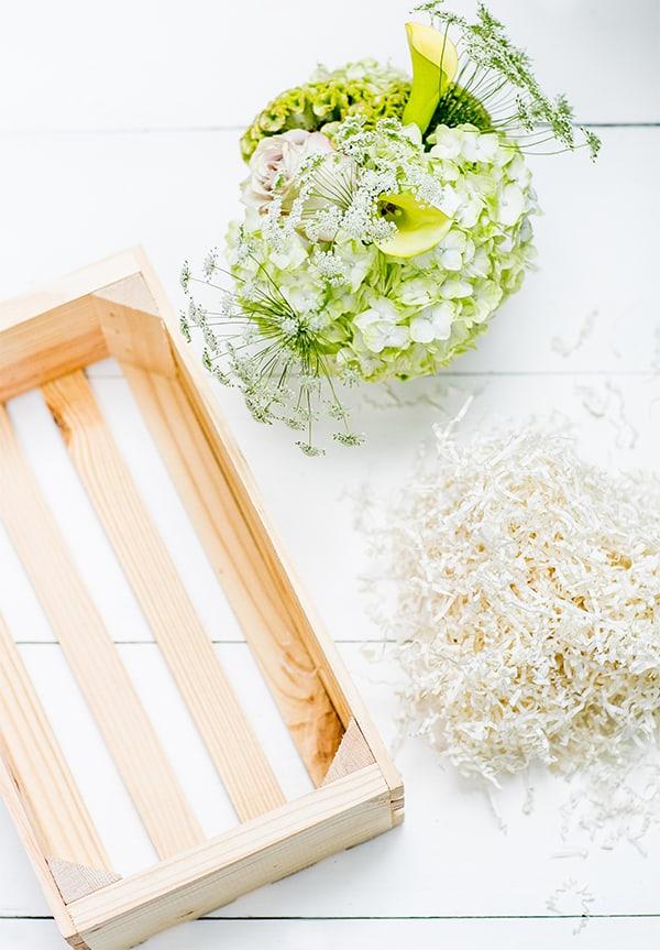 wooden gift box, flowers and shredding