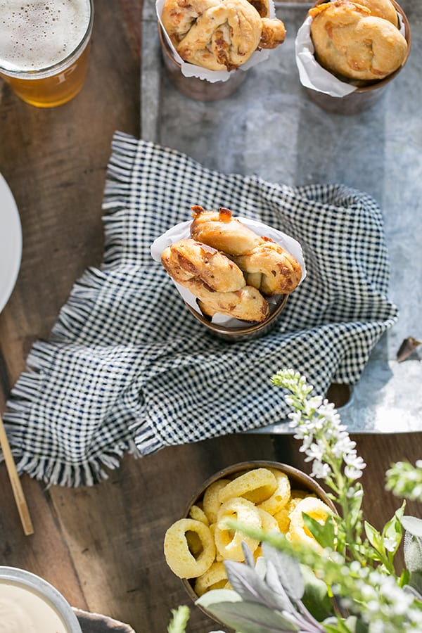easy pretzel recipe on a table with napkin and beer