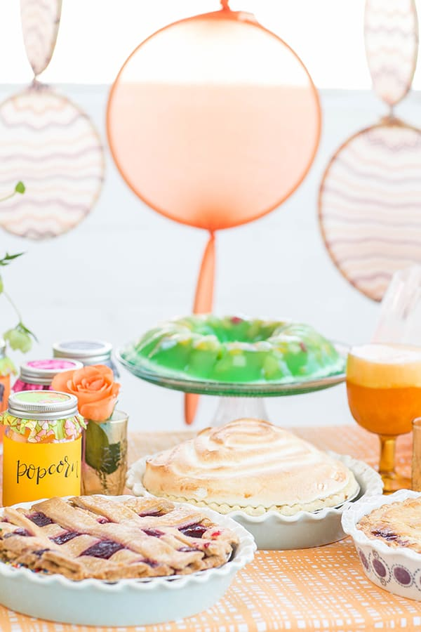 Vintage pies on a colorful table for an Amy Sedaris party