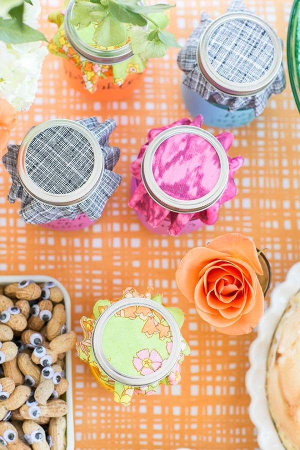 Colorful jars with fabric coverings