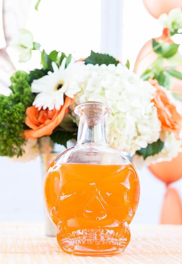 Orange punch in a skull vase