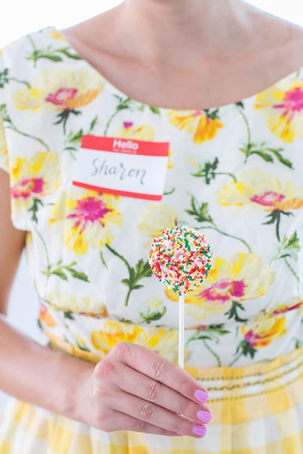 Girl holding an Oreo lollipop with sprinkles