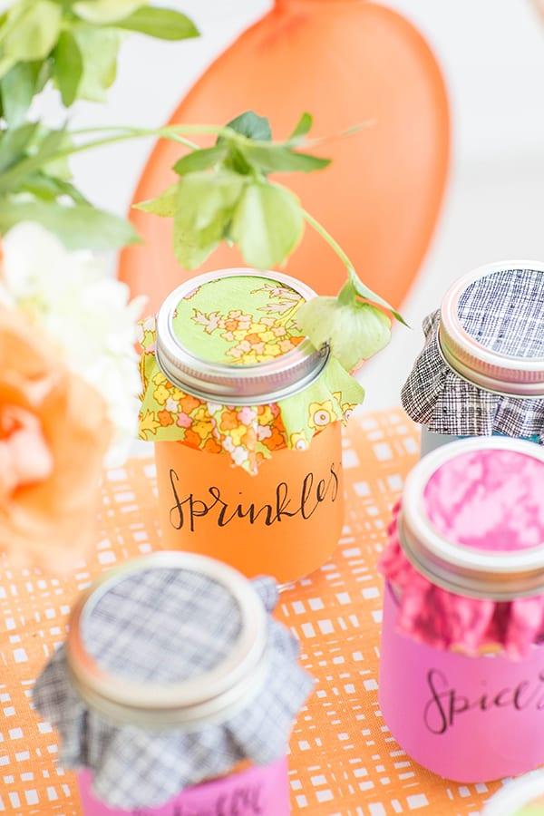 Amy Sedaris colorful jars with fabric on them