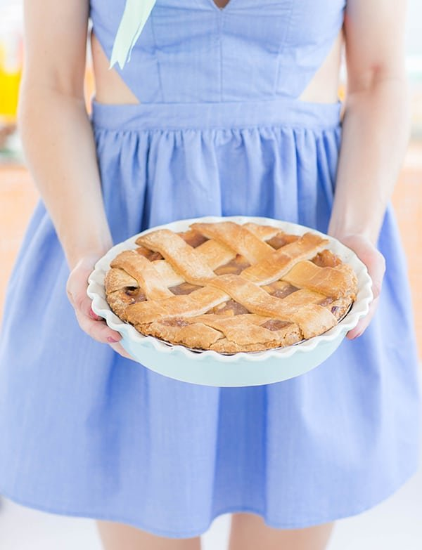Girl holding an apple pie