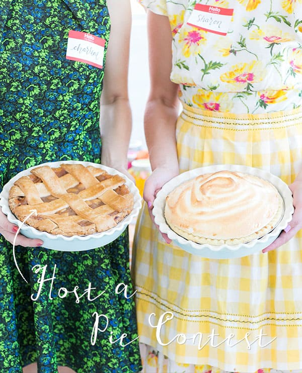 Girls in vintage aprons holding an apple pie and cream pie