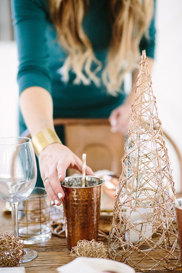 eden placing copper tumbler on a table