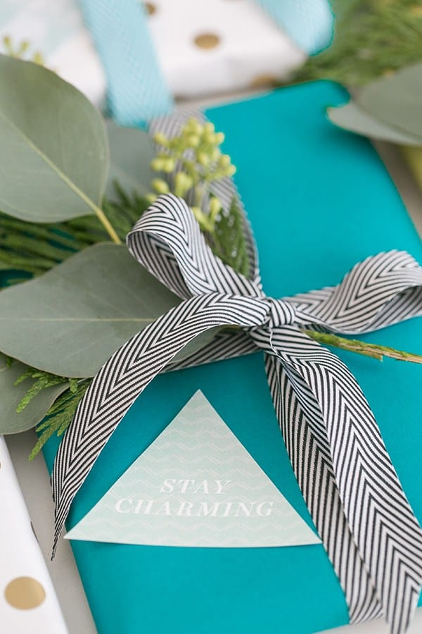 holiday gift tags that say stay charming.