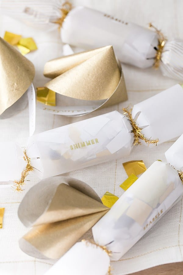 Confetti poppers and gold fortune cookies
