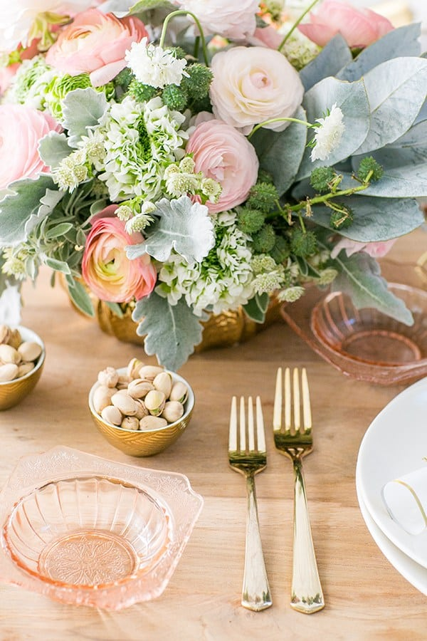 Gold flatware and flowers for New Year's Eve