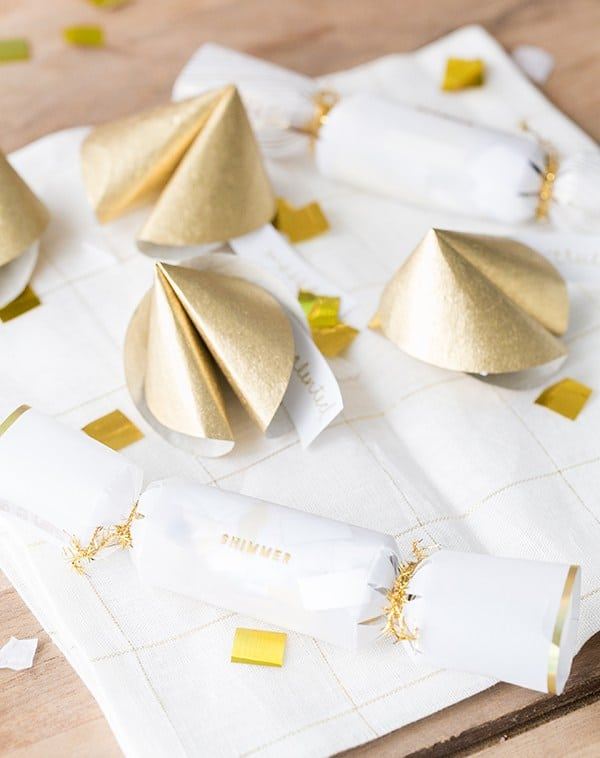 Paper fortune cookies with confetti and napkins