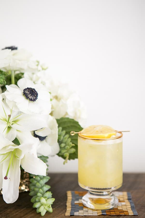 Spiked lemonade with coaster and flowers for an Oscar party