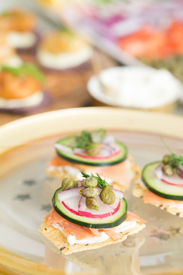 Oscar party canapés with salmon, cucumber, capers and onions.