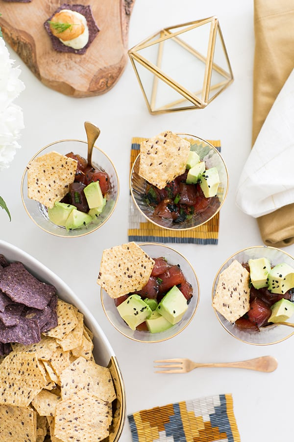 Ahi poke in small bowls with chips for an Oscar party.