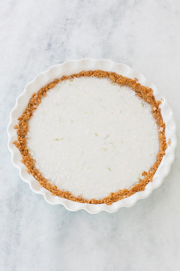 coconut key lime pie recipe on a marble table.
